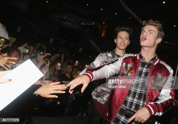 Michael Conor and Brady Tutton of the group 'In Real Life' the grand prize winner of ABC's 'Boy Band' performs at Planet Hollywood Times Square on...