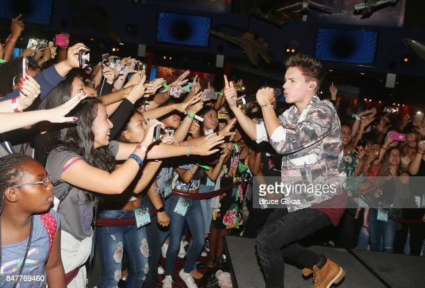 Michael Conor of the group 'In Real Life' the grand prize winner of ABC's 'Boy Band' performs at Planet Hollywood Times Square on September 15 2017...