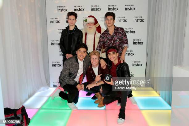 Michael Conor Santa Claus and Chance Perez Sergio Calderon Brady Tutton and Drew Ramos of In Real Life attend the 1027 KIIS FM Artist Gift Lounge at...