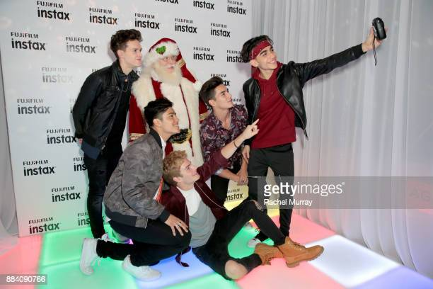 Michael Conor Santa Claus Sergio Calderon Brady Tutton Chance Perez and Drew Ramos of In Real Life attend the 1027 KIIS FM Artist Gift Lounge at 1027...