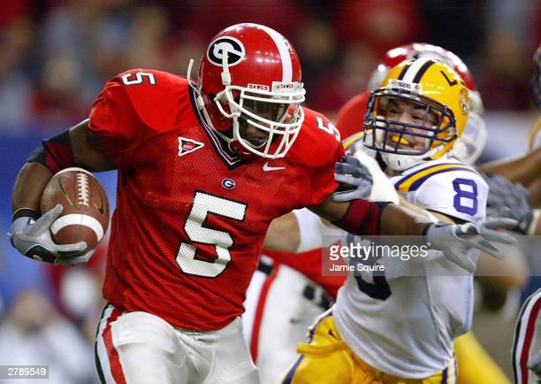 Michael Cooper of Georgia outruns Jack Hunt of LSU during the SEC Championship Game between the LSU Tigers and the Georgia Bulldogs on December 6...