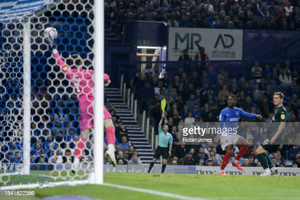 Michael Cooper of Plymouth Argyle saves from Mahlon Romeo but his effort was ruled offside during the Sky Bet League One match between Portsmouth and...