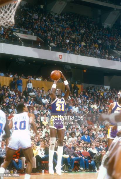 Michael Cooper of the Los Angeles Lakers shoots against the Philadelphia 76ers during an NBA basketball game circa 1983 at The Spectrum in...