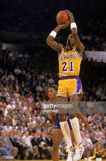 Michael Cooper of the Los Angeles Lakers shoots past Dennis Rodman of the Detroit Pistons during an NBA game at the Great Western Forum in Los...