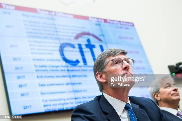 Michael Corbat left CEO of Citigroup and Jamie Dimon CEO of JPMorgan Chase testify during a House Financial Services Committee hearing in Rayburn...