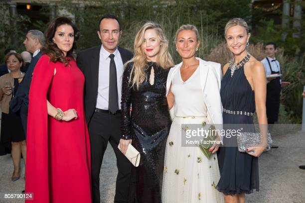 Michael Coste Melissa George Claire Duroc Danner and guests arrive for the amfAR Paris Dinner at Le Petit Palais on July 2 2017 in Paris France
