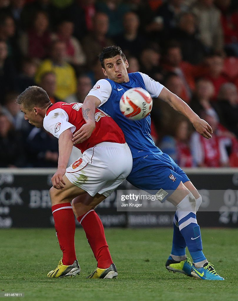 Michael Coulson of York City competes for the ball with Charlie Taylor of Fleetwood Town during the Sky Bet League Two play off Semi Final second leg match between Fleetwood Town and York City at Highbury Stadium on May 16, 2014 in Fleetwood, England.