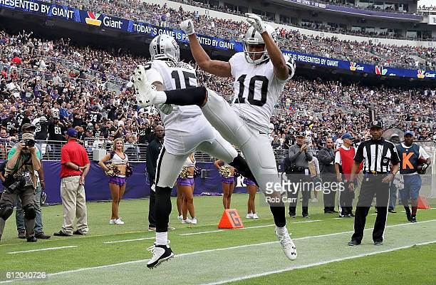 Michael Crabtree and Seth Roberts of the Oakland Raiders celebrate after Crabtree scored a touchdown in the second quarter against the Baltimore...