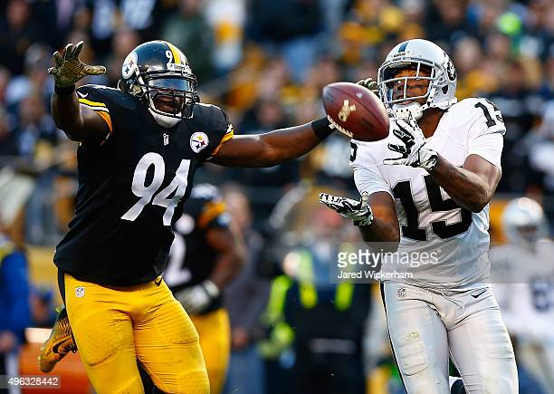 Michael Crabtree of the Oakland Raiders catches a game tying touchdown pass in front of Lawrence Timmons of the Pittsburgh Steelers in the 4th...