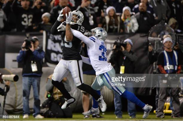 Michael Crabtree of the Oakland Raiders catches a pass for a touchdown against the Dallas Cowboys during their NFL game at OaklandAlameda County...