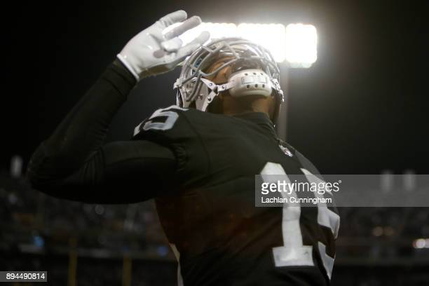 Michael Crabtree of the Oakland Raiders celebrates after a twoyard touchdown catch against the Dallas Cowboys during their NFL game at OaklandAlameda...