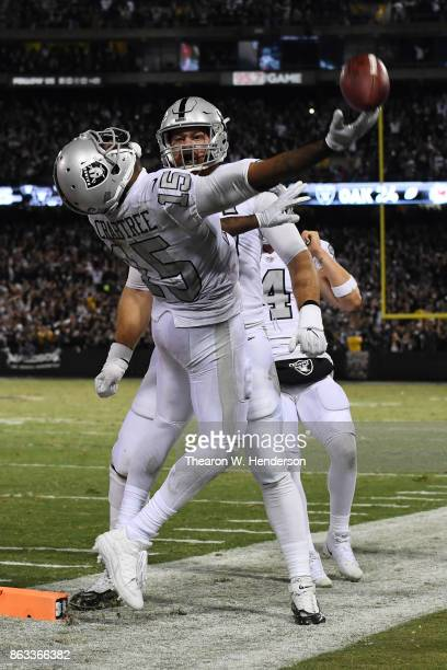 Michael Crabtree of the Oakland Raiders celebrates after scoring on a twoyard touchdown catch against the Kansas City Chiefs to tie the game 3030...