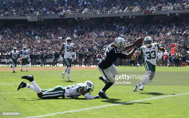 Michael Crabtree of the Oakland Raiders gets past Juston Burris and Jamal Adams of the New York Jets to score a touchdown at OaklandAlameda County...
