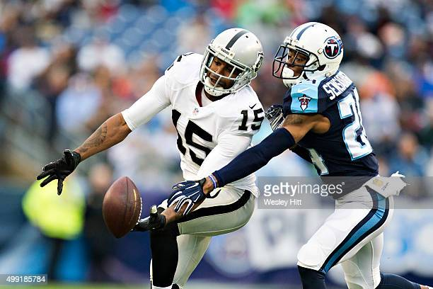 Michael Crabtree of the Oakland Raiders has a pass knocked away by Coty Sensabaugh of the Tennessee Titans at Nissan Stadium on November 29 2015 in...