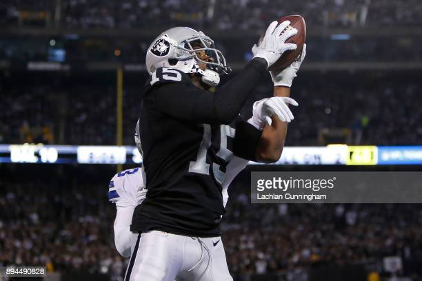 Michael Crabtree of the Oakland Raiders makes a catch for a twoyard touchdown against the Dallas Cowboys during their NFL game at OaklandAlameda...
