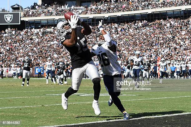 Michael Crabtree of the Oakland Raiders scores on a 21yard pass against the San Diego Chargers during their NFL game at OaklandAlameda County...