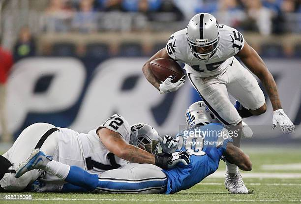 Michael Crabtree of the Oakland Raiders tires to avoid the tackle by Dwight Bentley of the Detroit Lions in the second quarter at Ford Field on...