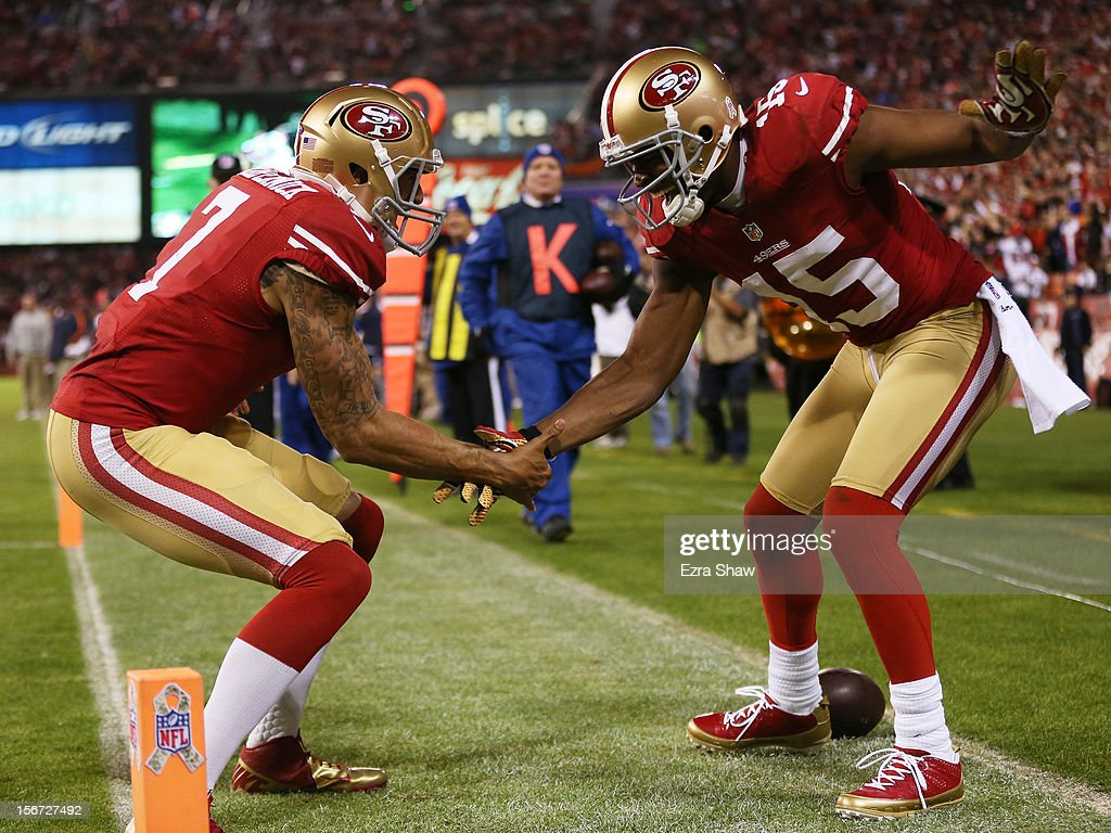 Michael Crabtree #15 of the San Francisco 49ers and Colin Kaepernick #7 of the San Francisco 49ers celebrate Crabtree's third quarter touchdown against the Chicago Bears at Candlestick Park on November 19, 2012 in San Francisco, California.