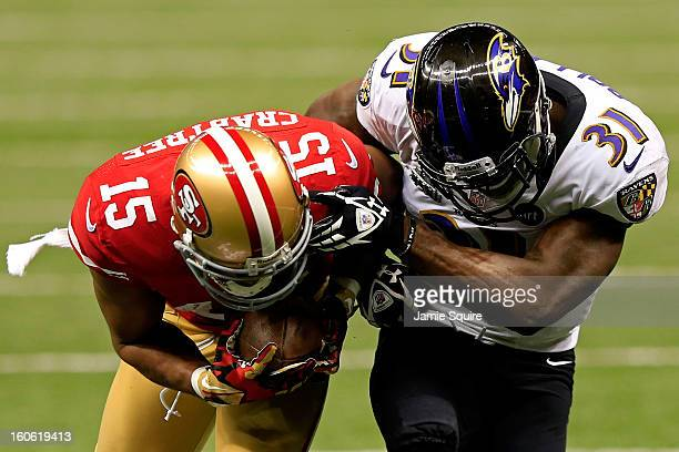 Michael Crabtree of the San Francisco 49ers breaks a tackle against Bernard Pollard of the Baltimore Ravens and runs in for a touchdown in the third...