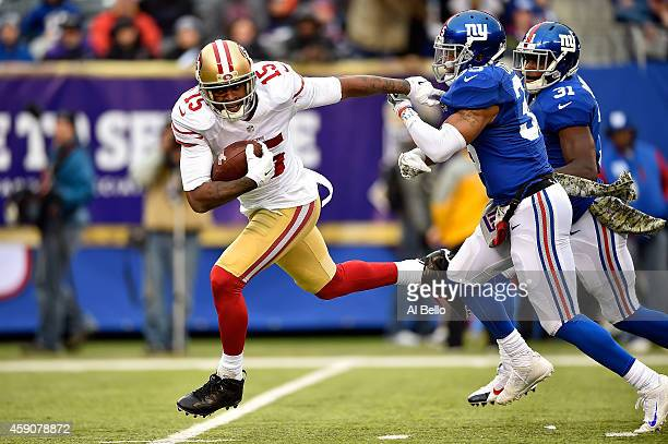 Michael Crabtree of the San Francisco 49ers breaks free from Quintin Demps of the New York Giants on his way to scoring a touchdown in the third...