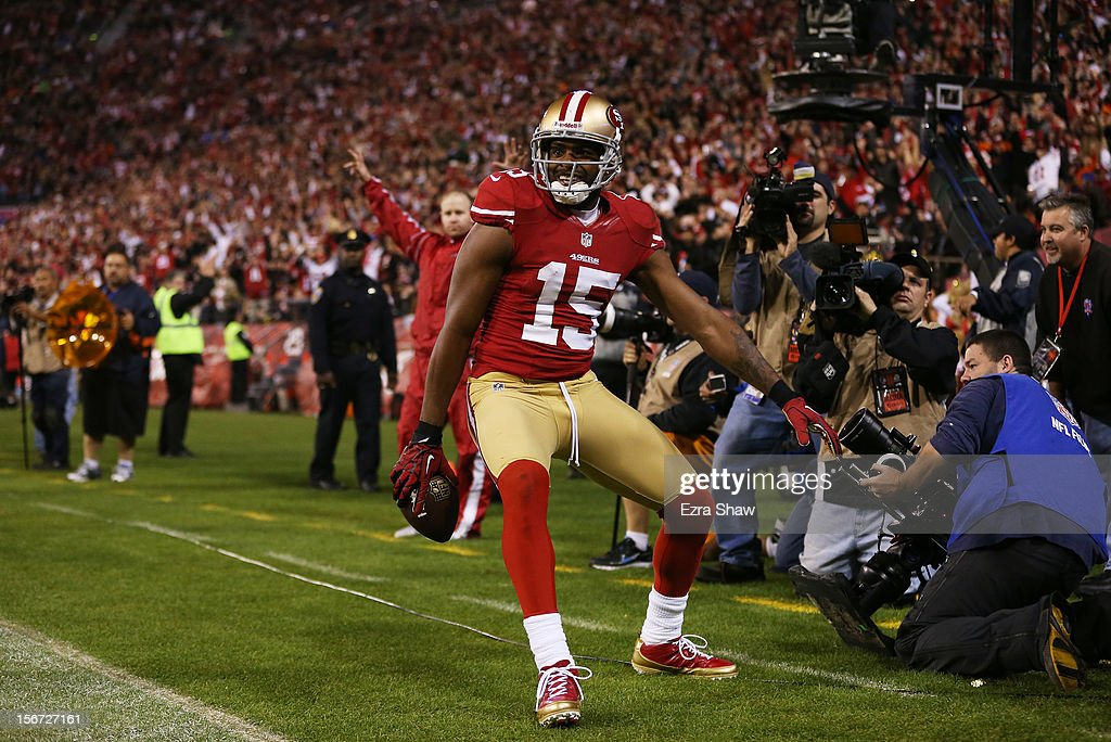 Michael Crabtree #15 of the San Francisco 49ers celebrates catching a third quarter touchdown pass against the Chicago Bears at Candlestick Park on November 19, 2012 in San Francisco, California.