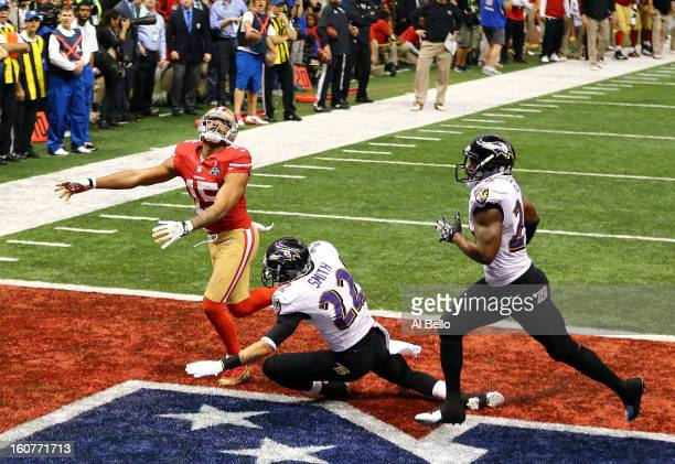 Michael Crabtree of the San Francisco 49ers is unable to come up with a fourth down catch in the end zone late in the fourth quarter against Ed Reed...