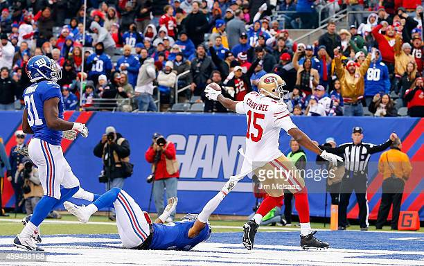 Michael Crabtree of the San Francisco 49ers runs in a third quarter touchdown against Quintin Demps of the New York Giants at MetLife Stadium on...