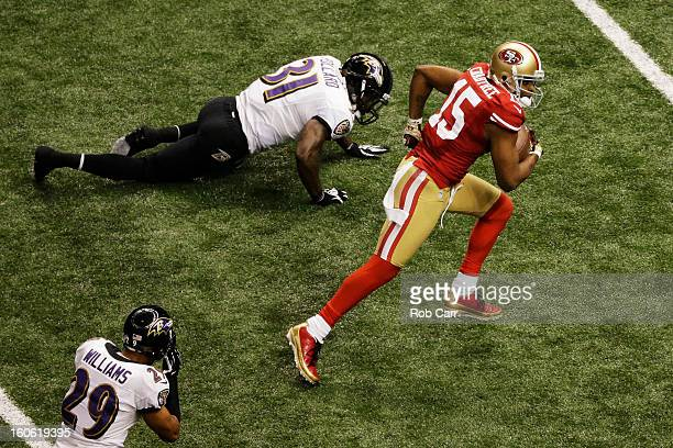 Michael Crabtree of the San Francisco 49ers runs into the endzone on a 31yard touchdown reception in the third quarter against Bernard Pollard of the...