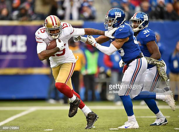 Michael Crabtree of the San Francisco 49ers scores a touchdown against Quintin Demps of the New York Giants during their game at MetLife Stadium on...