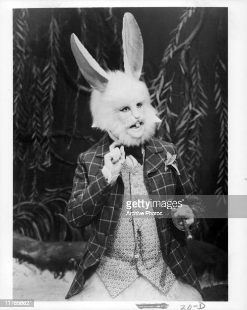 Michael Crawford as the White Rabbit gesturing while holding a cigar in a scene from the film 'Alice's Adventures In Wonderland' 1973