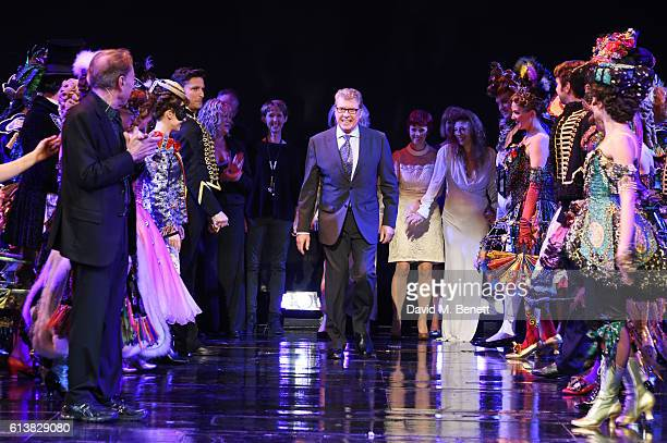 Michael Crawford bows onstage surrounded by members of the original London cast at 'The Phantom Of The Opera' 30th anniversary charity gala...