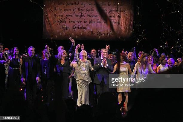 Michael Crawford bows onstage surrounded by members of the original London cast at The Phantom Of The Opera 30th anniversary charity gala performance...