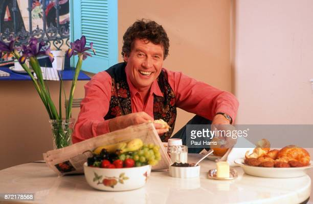 Michael Crawford in his Hollywood apartment eating a breakfast of fruit and pastries August 9 1991 Hollywood Los Angeles California