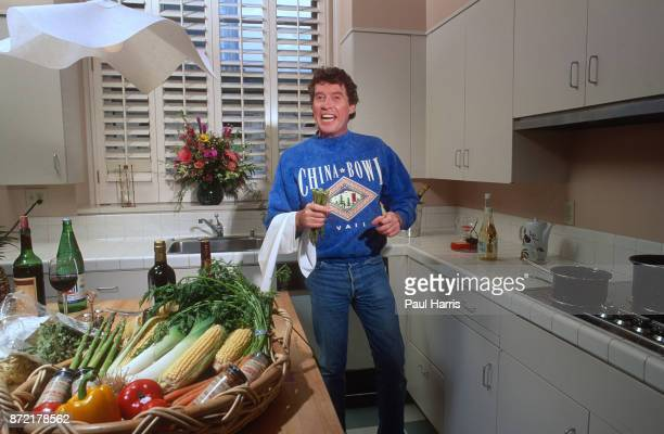 Michael Crawford in his Hollywood apartment preparing food in the kitchen August 9 1991 Hollywood Los Angeles California
