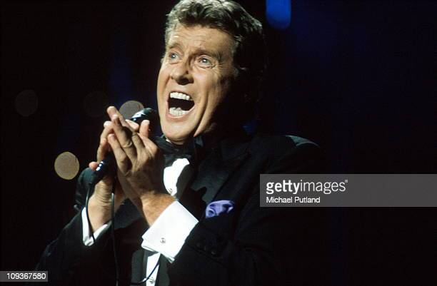Michael Crawford performs on stage London 1990