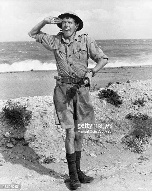 Michael Crawford saluting in a scene from the film 'How I Won The War', 1967.