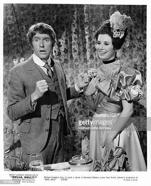 Michael Crawford tries to avoid a check in with Marianne McAndrew in a scene from the film 'Hello Dolly!', 1969.