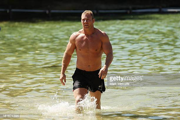 Michael Crocker walks from the ocean during a South Sydney Rabbitohs NRL recovery session at Clovelly Beach on September 23 2013 in Sydney Australia