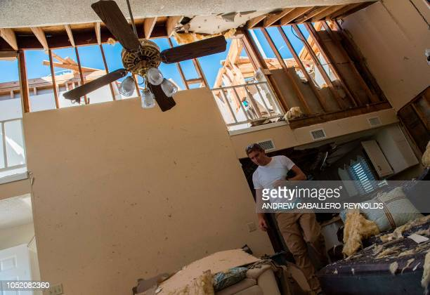 Michael Crossley walks through his home that was washed across the street in Port St Joe beach Florida on October 13 three days after hurricane...