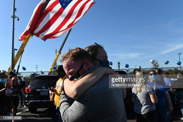 Michael Crowley and Gaby Poletaev embrace as supporters of president-elect Joe Biden celebrate his victory in the 2020 presidential election outside...