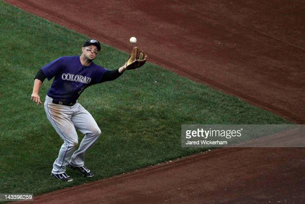 Michael Cuddyer of the Colorado Rockies catches a fly ball near foul territory against the Pittsburgh Pirates during the second game of a...