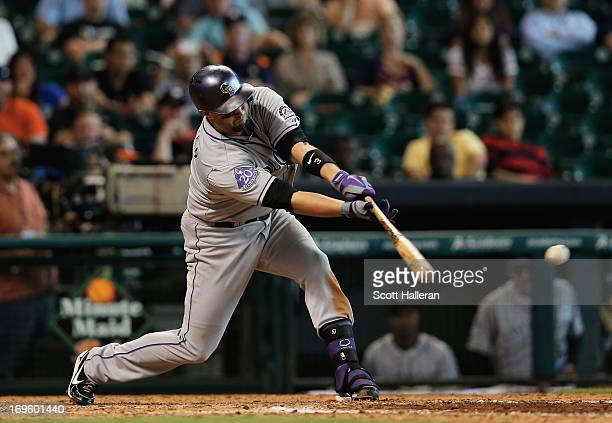Michael Cuddyer of the Colorado Rockies drives in the go ahead run during the ninth inning against the Houston Astros at Minute Maid Park on May 28...