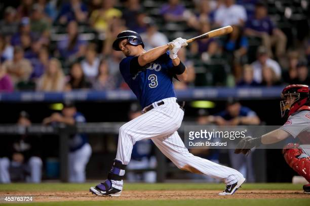 Michael Cuddyer of the Colorado Rockies hits a solo home run hit in the sixth inning during the second game of a split double header at Coors Field...