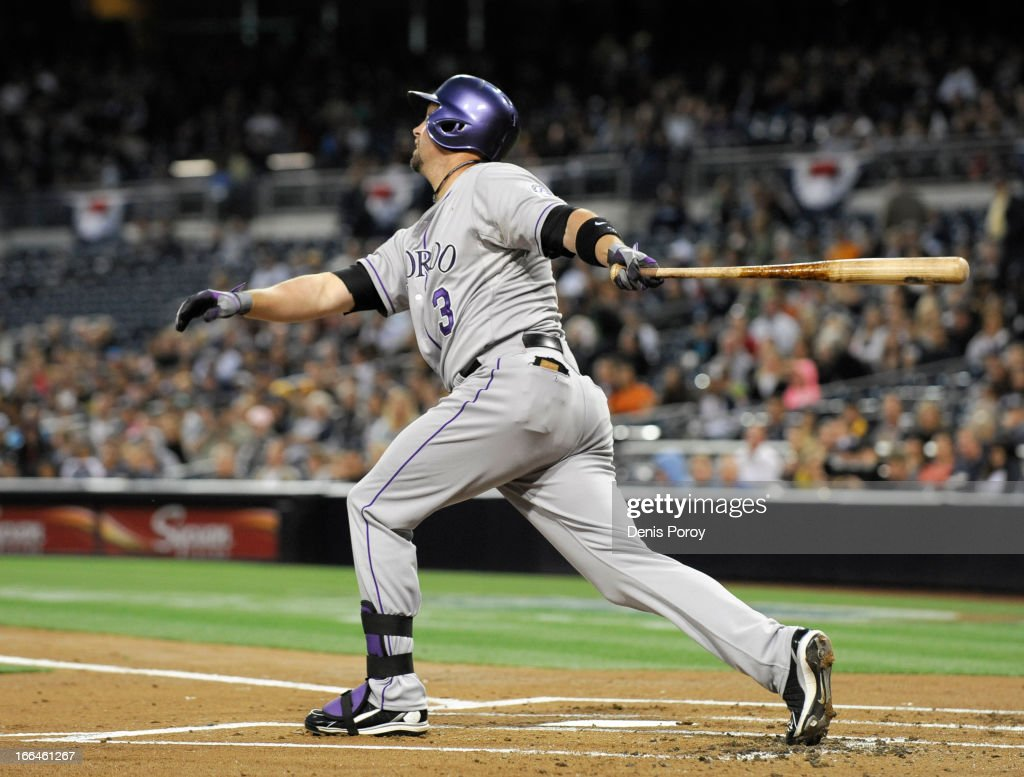 Michael Cuddyer #3 of the Colorado Rockies hits an RBI single in the first inning during a baseball game against the San Diego Padres at Petco Park on April 12, 2013 in San Diego, California.