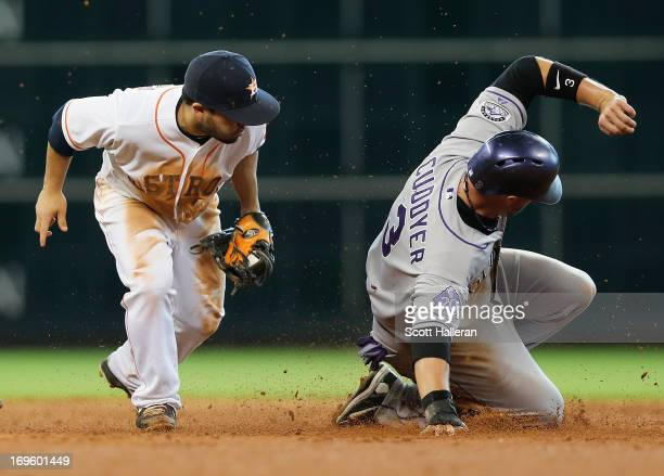 Michael Cuddyer of the Colorado Rockies is safe at second base during the ninth inning under the tag of the Jose Altuve of Houston Astros at Minute...