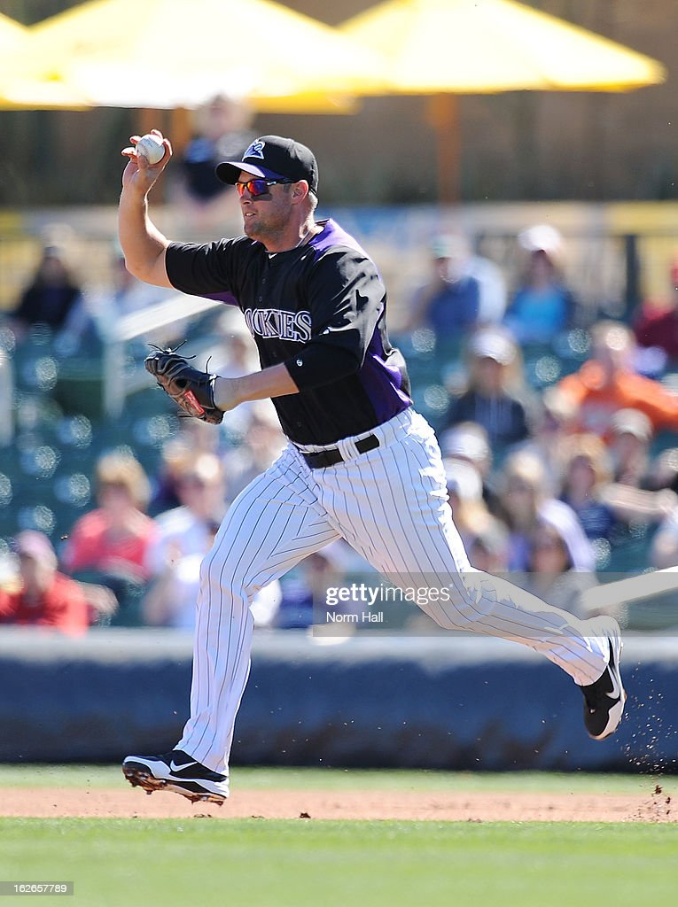 Michael Cuddyer #3 of the Colorado Rockies runs with the ball against the Texas Rangers at Salt River Field on February 25, 2013 in Scottsdale, Arizona.