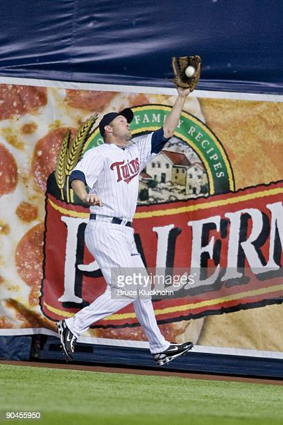 Michael Cuddyer of the Minnesota Twins catches a ball at the warning track against the Chicago White Sox on September 1, 2009 at the Metrodome in...