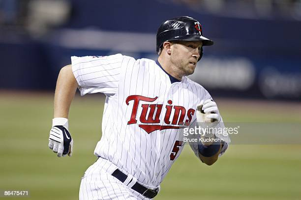 Michael Cuddyer of the Minnesota Twins runs to first on a double against the Los Angeles Angels in the third inning at the Metrodome on April 17,...