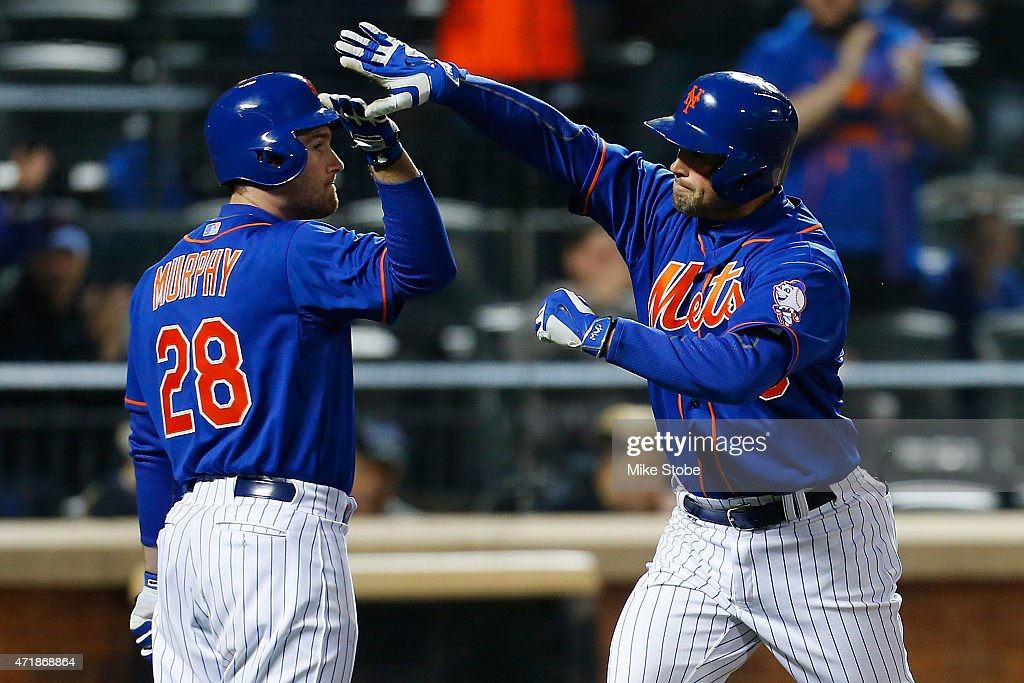 Michael Cuddyer #23 of the New York Mets celebrates with Daniel Murphy #28 after hitting a fourth inning home run against the Washington Nationalsat Citi Field on May 1, 2015 in the Flushing neighborhood of the Queens borough of New York City.