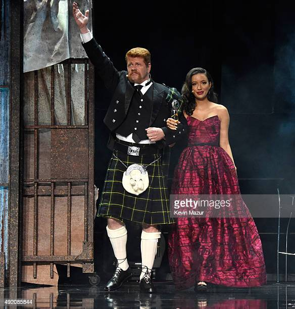 """Michael Cudlitz and Christian Serratos attend AMC's """"The Walking Dead"""" season 6 fan premiere event at Madison Square Garden on October 9, 2015 in New..."""